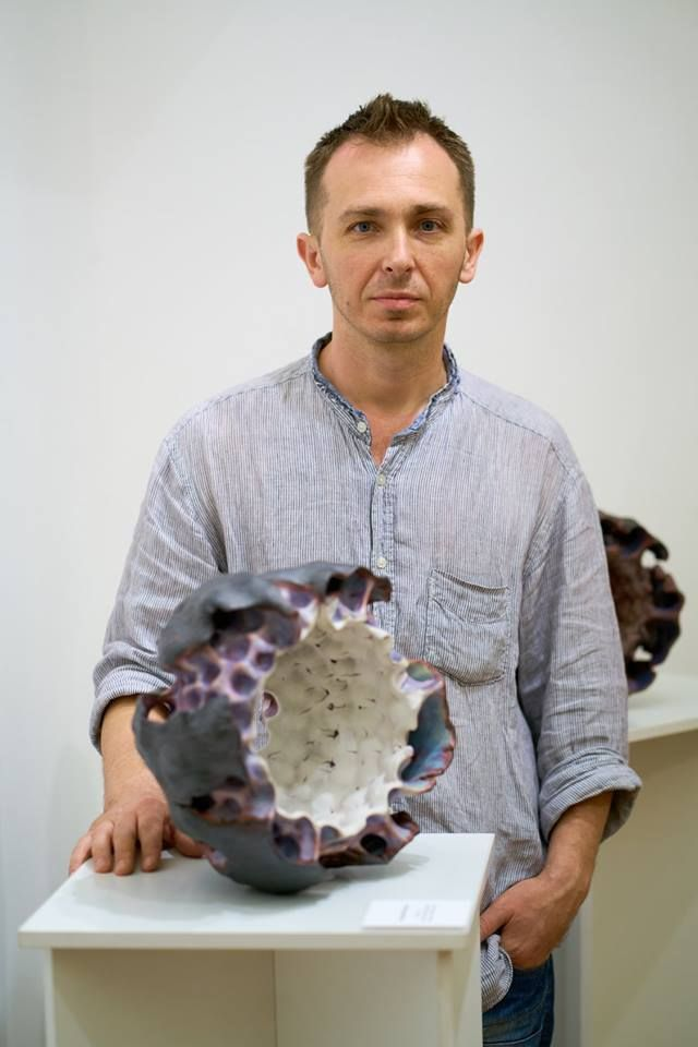 Andriy Kyrychenko with ceramic sculpture from the Shell series
