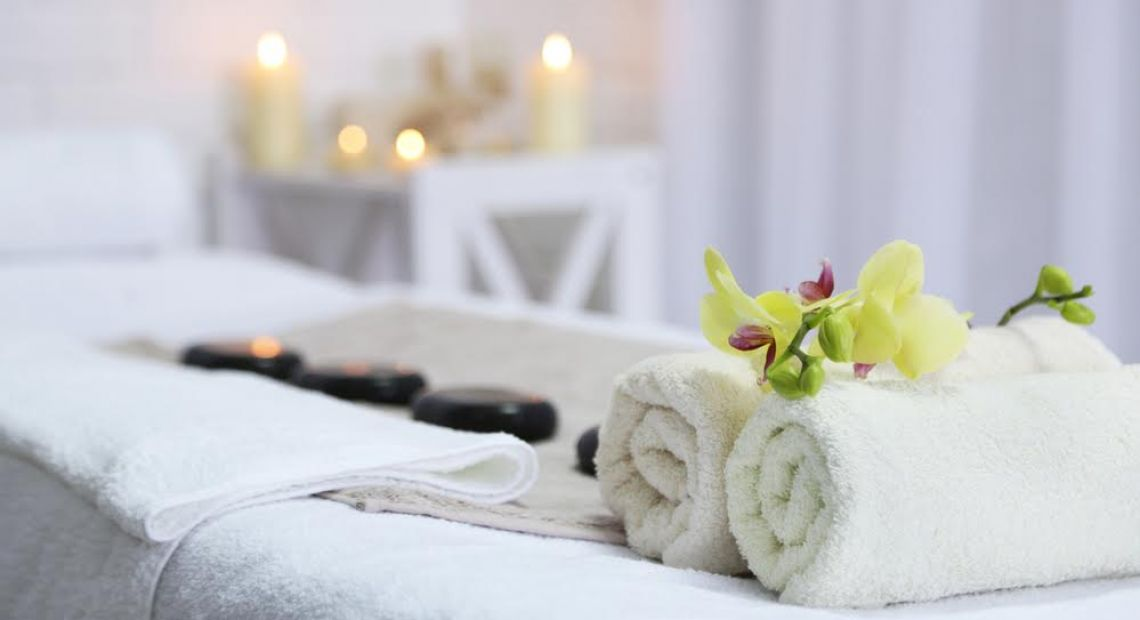 towels, flowers, stones and candles for SPA treatment