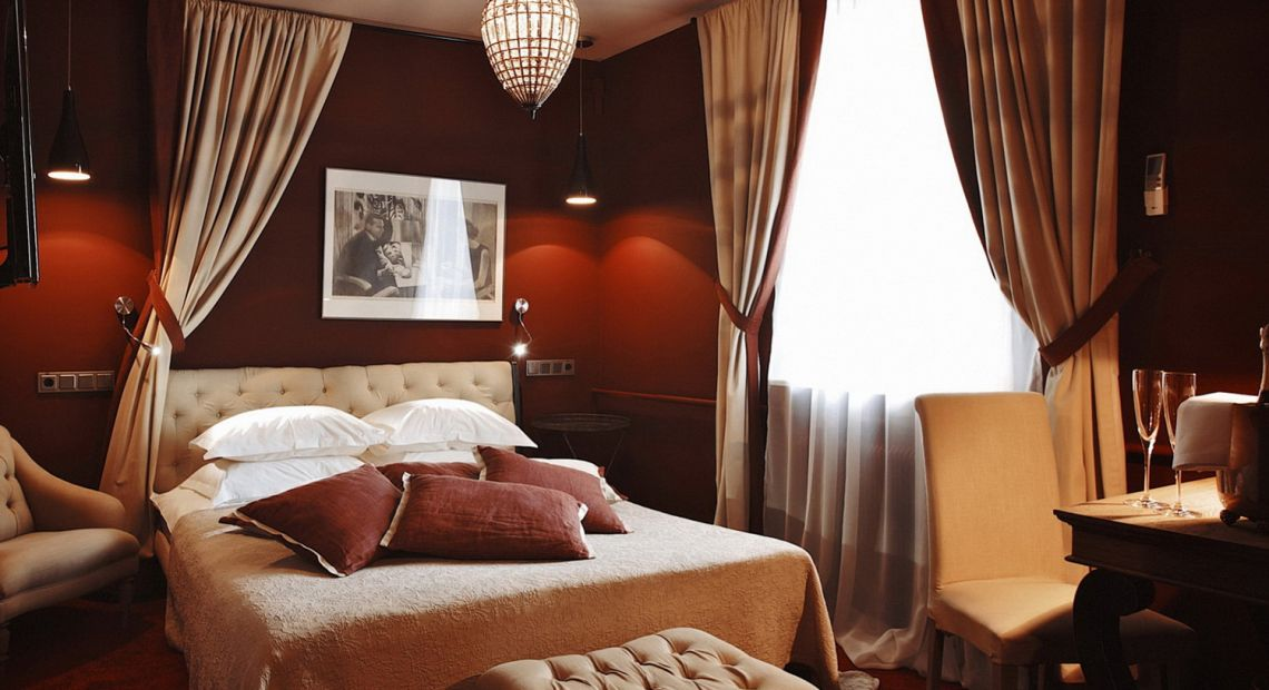 hotel room interior in red and beige colors