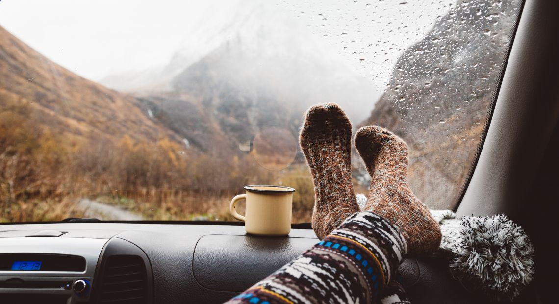 Person in warm socks on an autumn trip