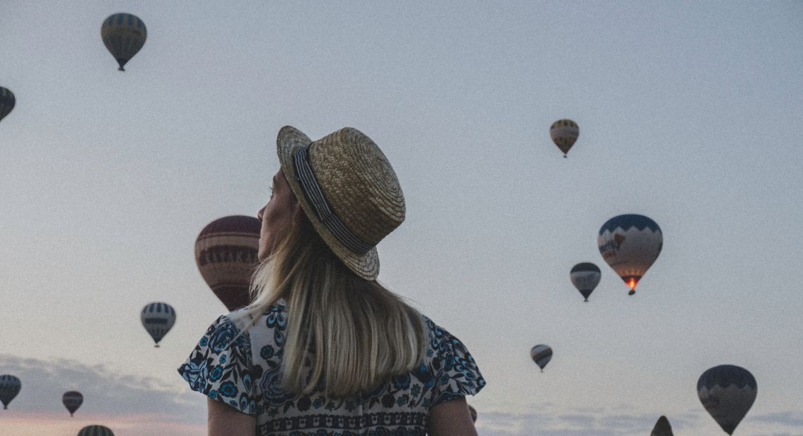 Girl watching hot air balloons in Turkey