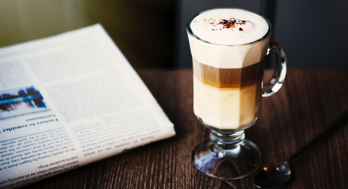 Hot coffee with cream and spices