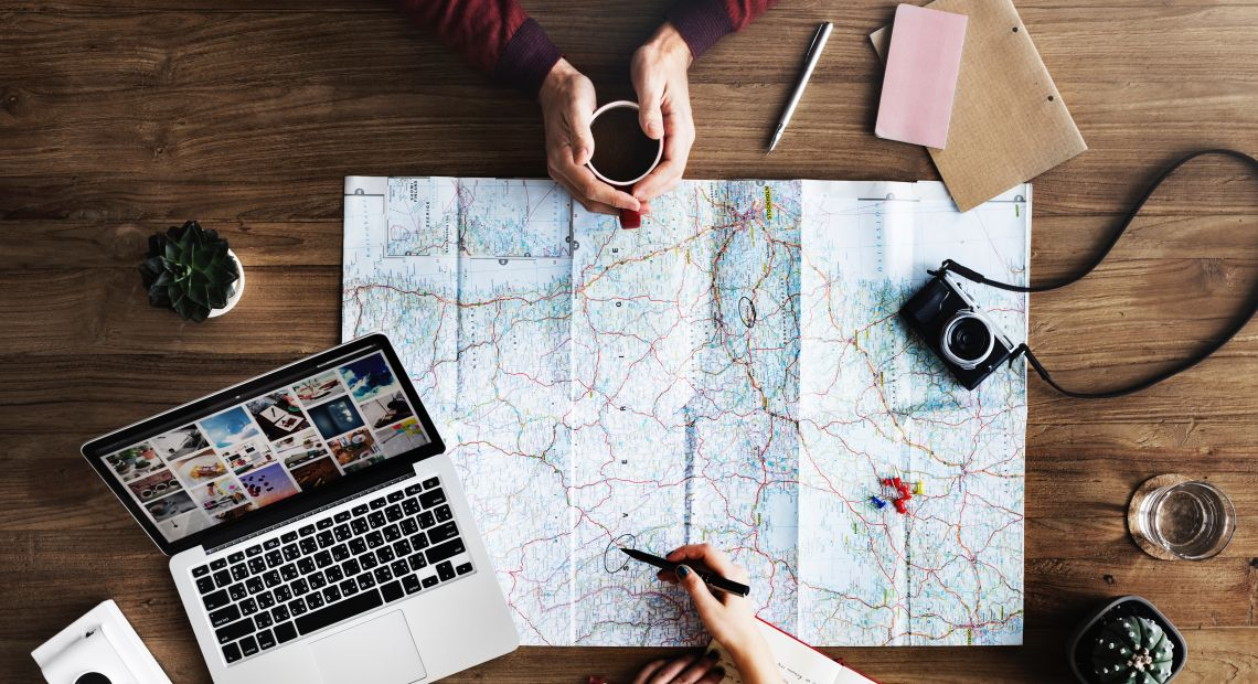 Maps and laptops to prepare for traveling