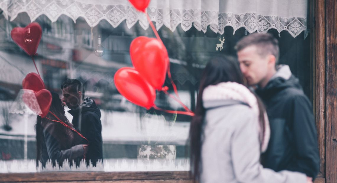 Couple with heart-shaped balloons
