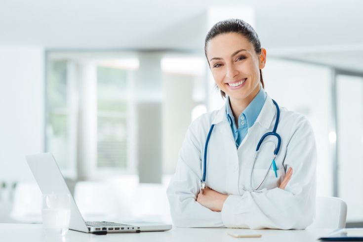 female doctor with laptop