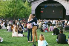 Couple hugging on an outdoor movie showing
