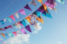 colorful festive bunting with blue sky on background