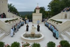 Priests sanctifying a church complex in Ukraine