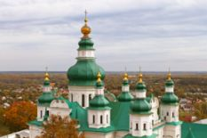 Church with green-and-golden domes in Chernigiv