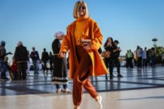 Woman in a bright orange coat on Paris Fashion Week 2018