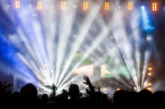 people on concert near illuminated stage