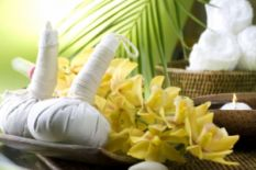 candles, towels and flowers for thai massage