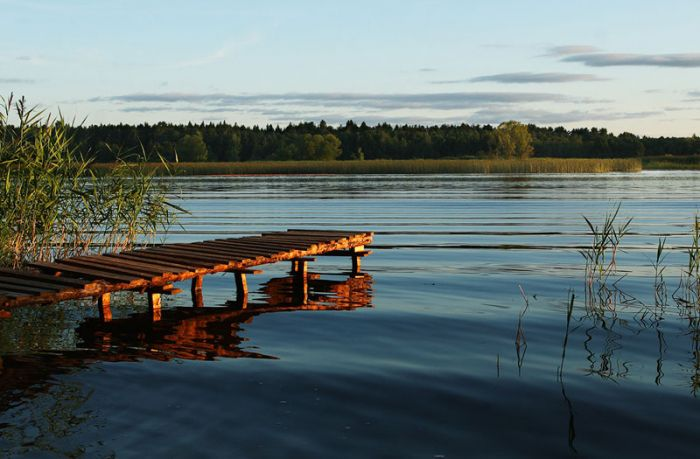 wooden pier on large lake