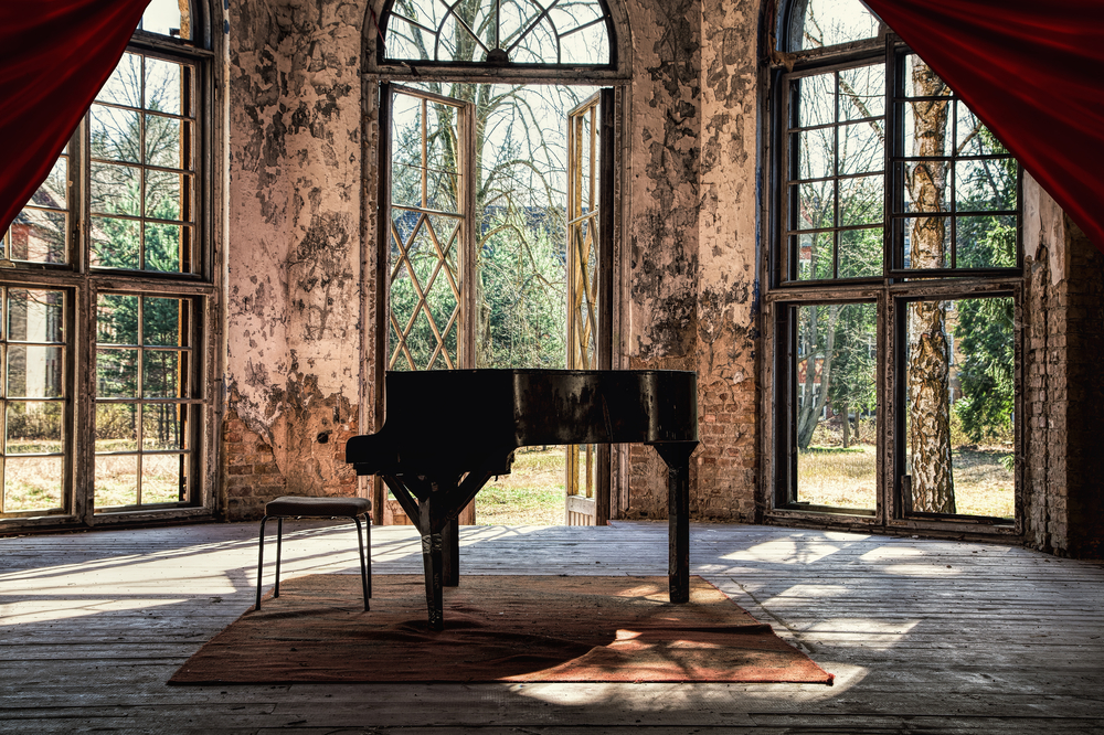 old piano in abandoned building