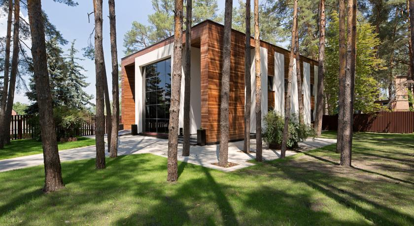 wooden building surrounded by pines