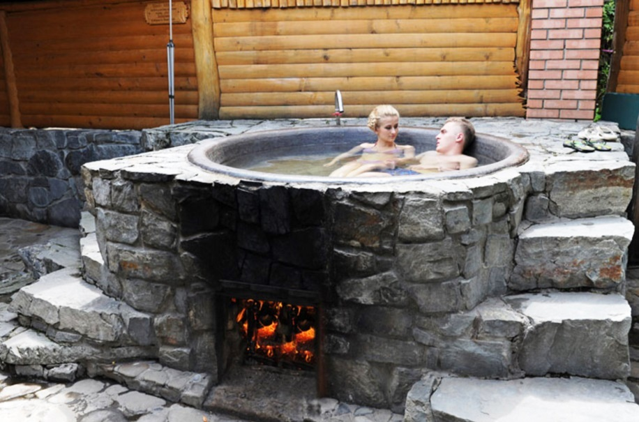 couple bathing in heated tank