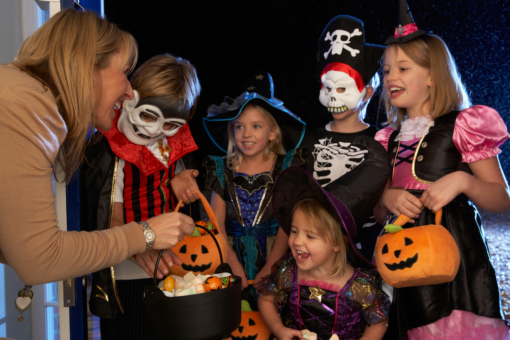 Kids choosing candy for Halloween