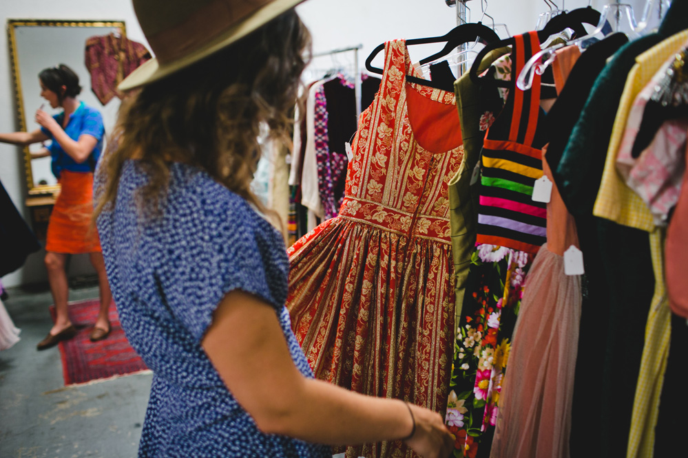 Woman checking out a vintage dress