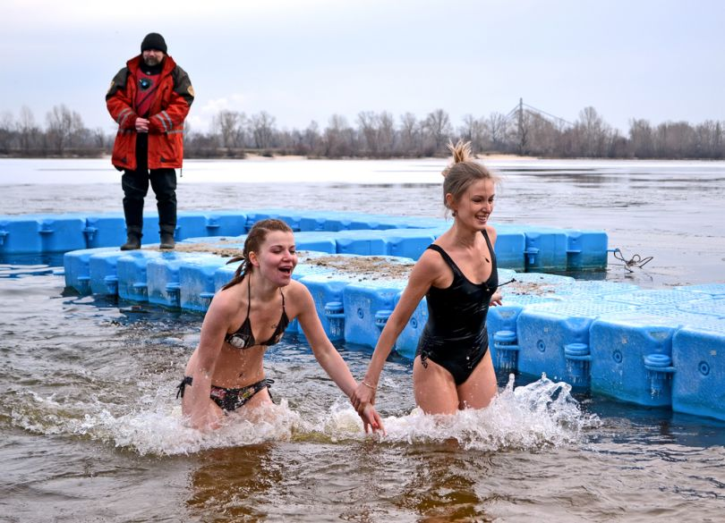 Girls plunging on Epiphany Day in Ukraine