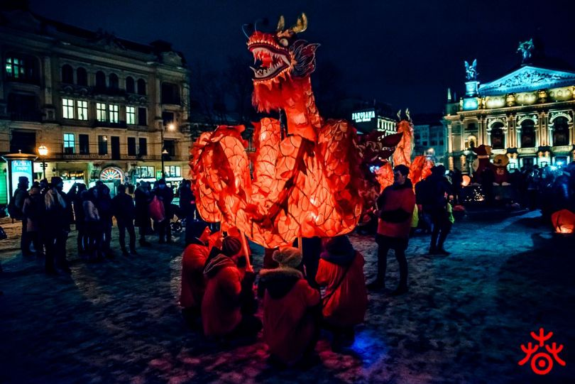 people holding large chinese dragon