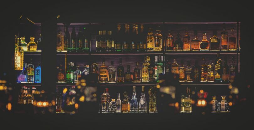 bar counter with many bottles