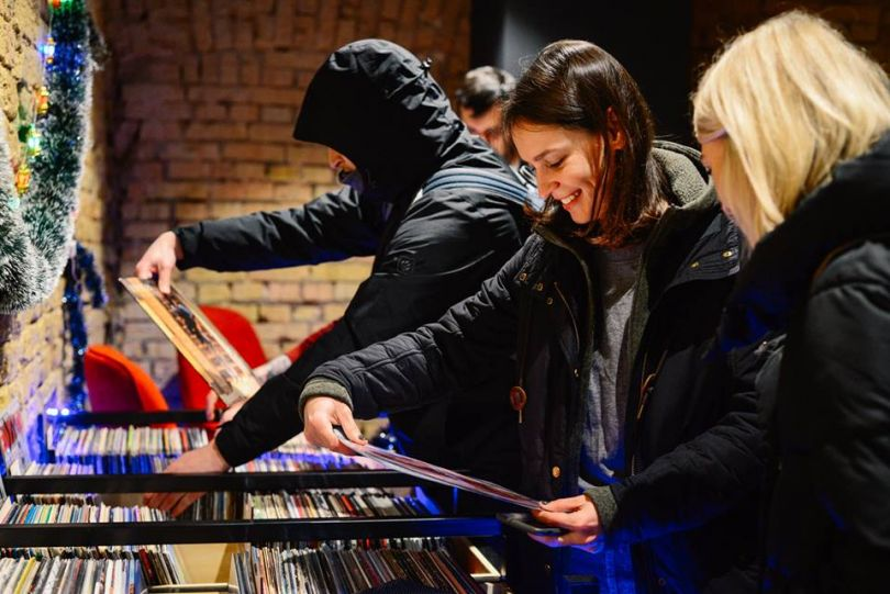 People choosing vinyl at Gram in Kyiv