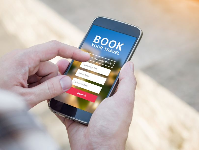 hands with smartphone with booking website open