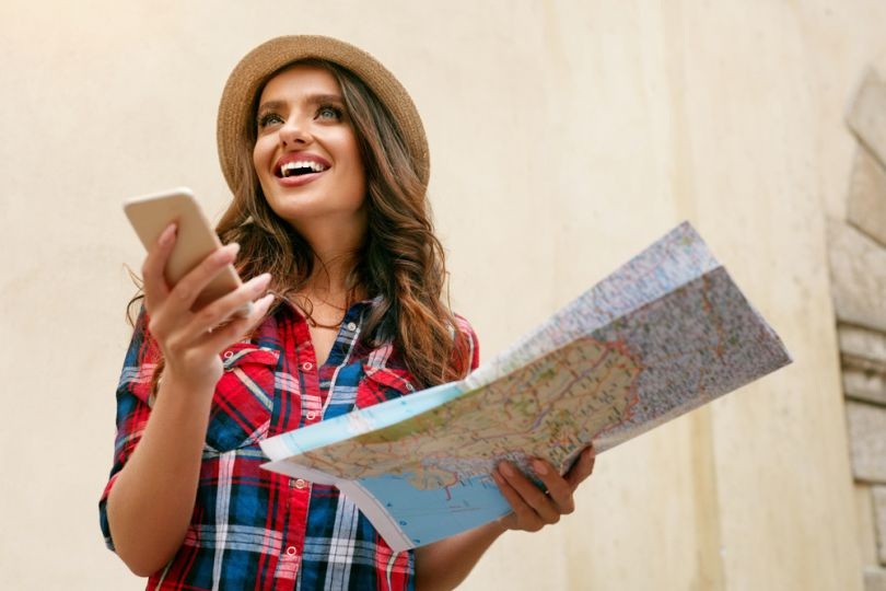 girl with map and smartphone