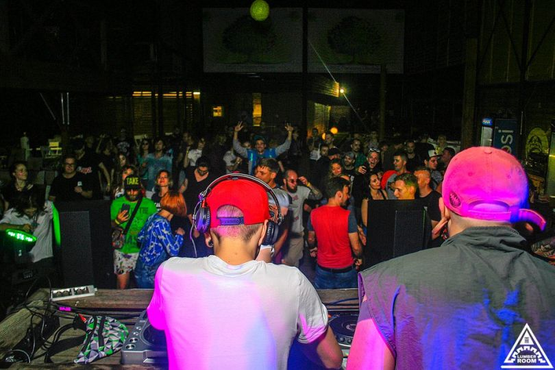 two djs playing in club