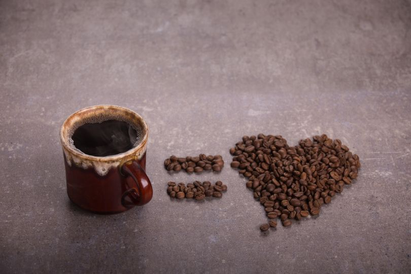 Coffee and heart made of coffee beans