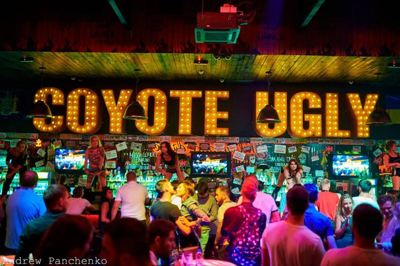 People in Ugly Coyote Saloon in Kyiv