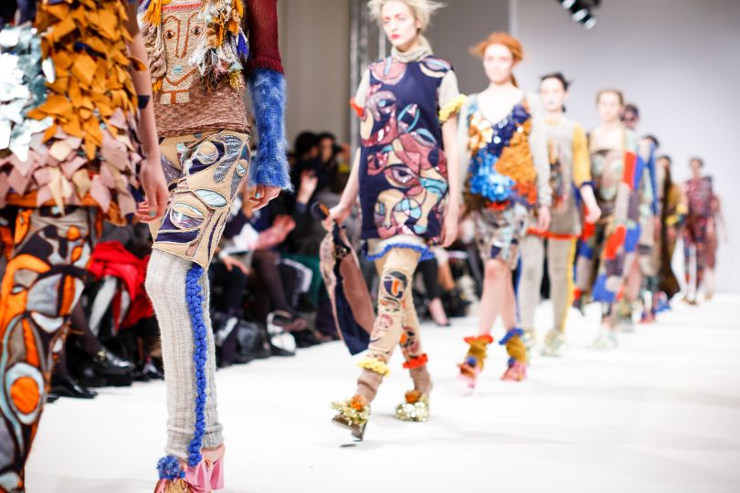 Models in colorful clothes on catwalk