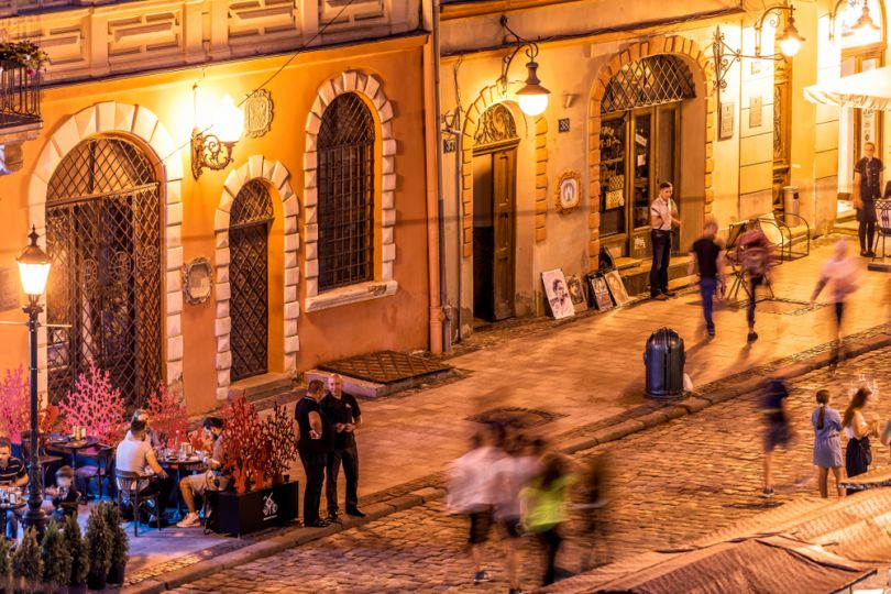 People chatting in night Lviv