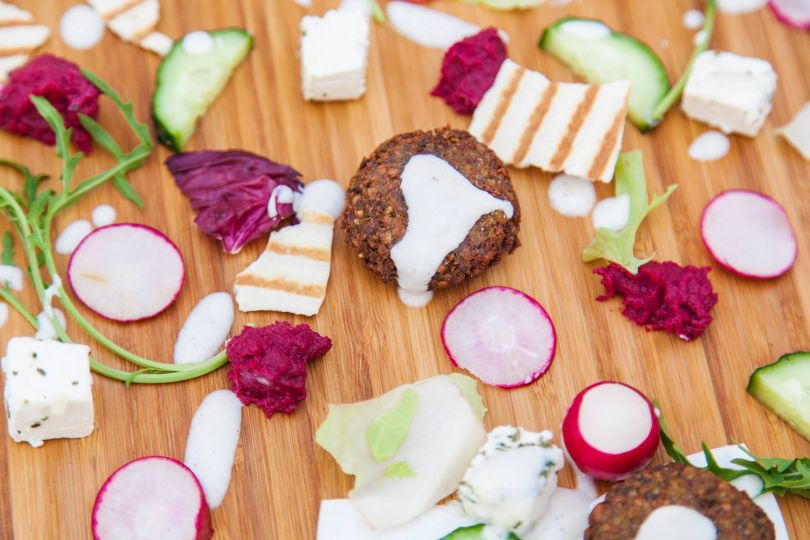 falafel and vegetables on wooden table