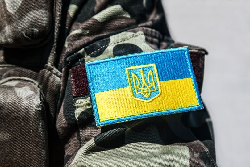 chevron with ukrainian flag on military suit