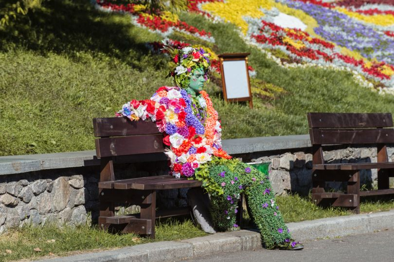 Flower man sitting in a Kyiv park