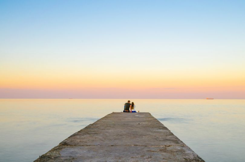 Couple meeting sunrise on Odesa beach