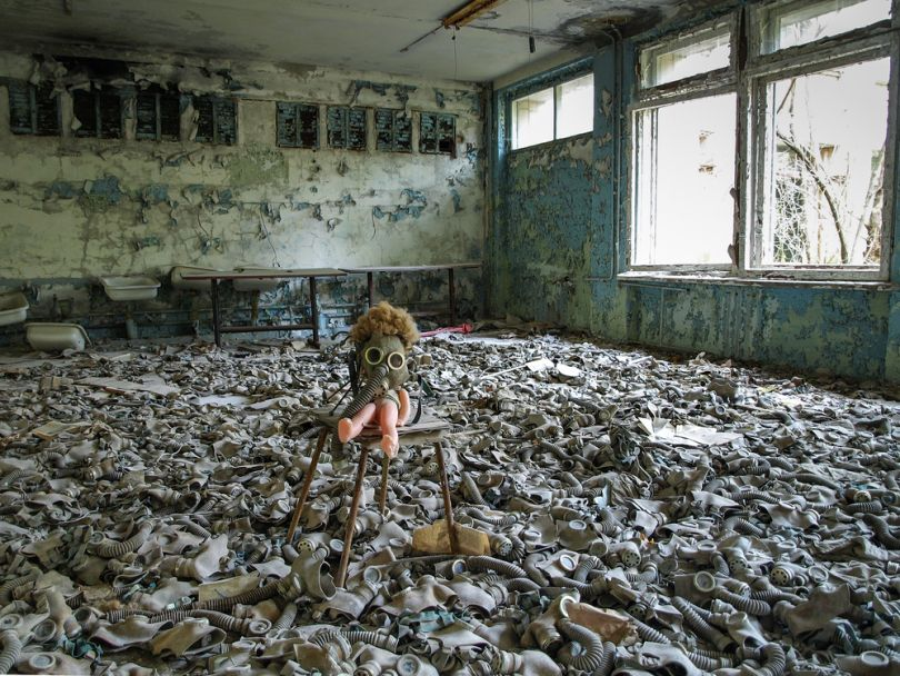 old doll and gas masks in building in chornobyl