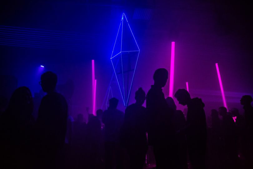 People dancing at neon disco