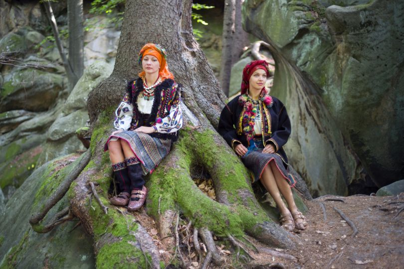 two girls in forest in hutsul clothes