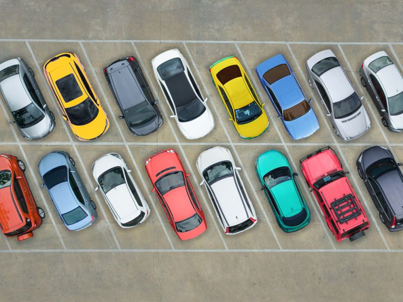 Parking lot filled with colorful cars