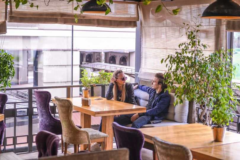 couple on restaurant`s warm terrace