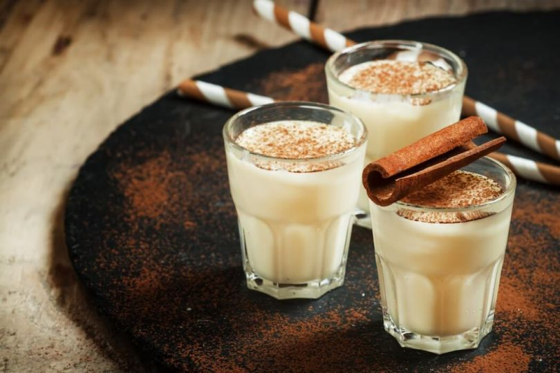 Gingerbread eggnog with cinnamon sticks