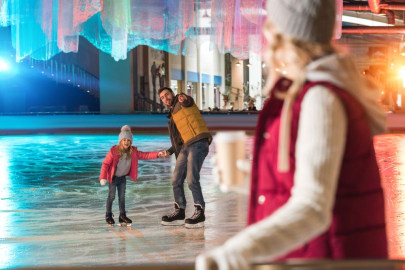 Family at a colorful ice rink
