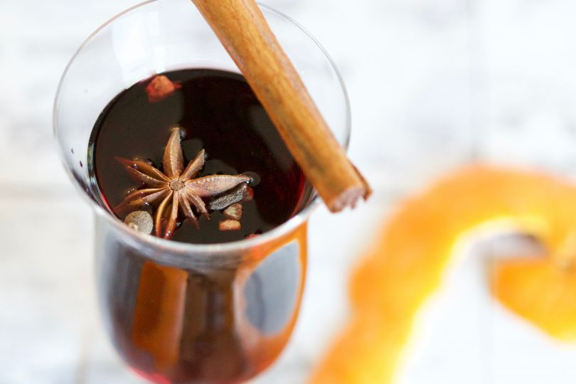 glass of mulled wine with cinnamon