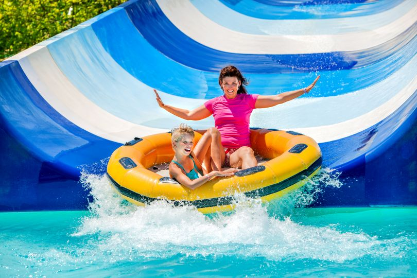 Woman sliding down in a water park