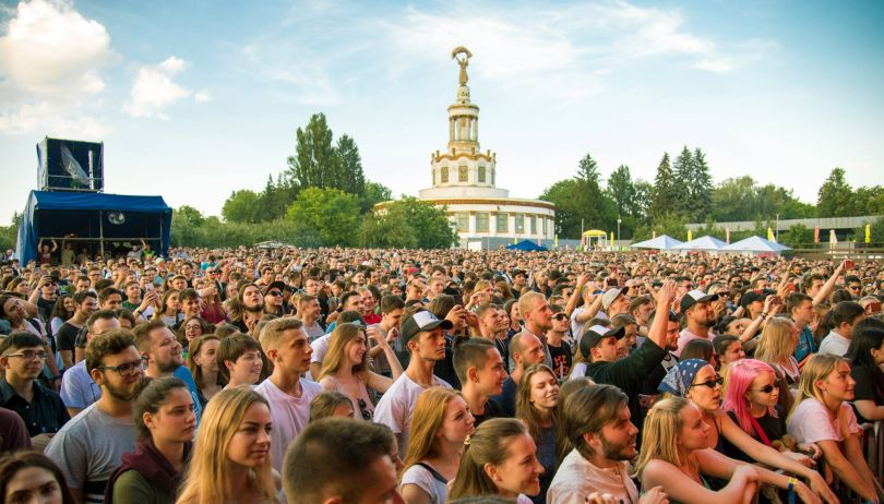 crowd on festival with soviet building on the background