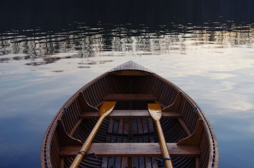 boat with paddles on water