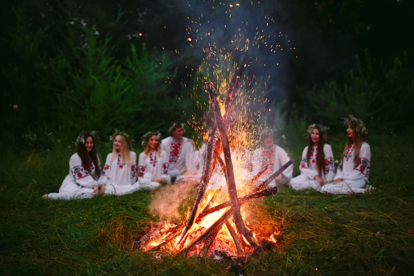 girls in white clothes near ivana kupala fire