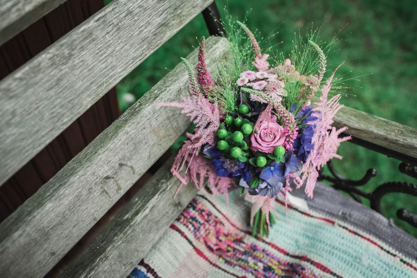 flowers composition on wooden bench